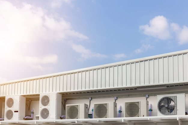 Group of external air conditioning and compressors units outside a building with blue sky background Premium Photo