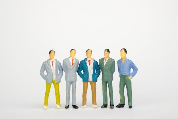Group of figure miniature businessman on white background Premium Photo