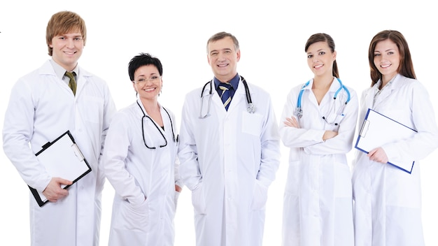 Group of five laughing successful doctors standing together Free Photo
