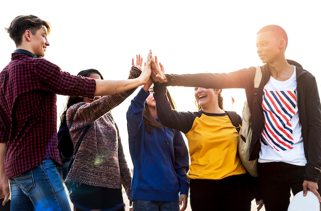 Group of friends all high five together Premium Photo