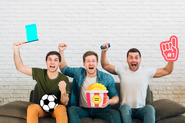 Group of friends being cheerful of a couch Free Photo