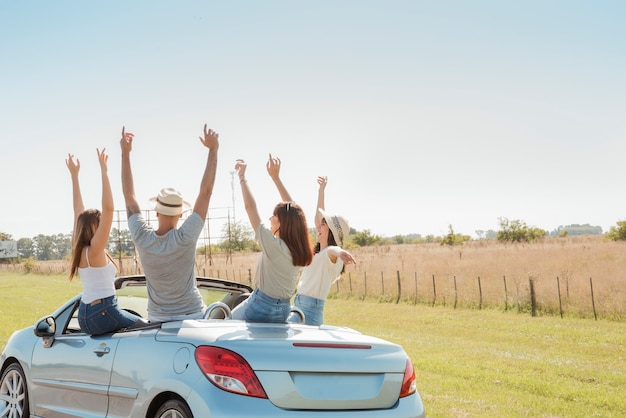 Group of friends doing a road trip Free Photo
