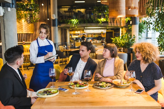 Group of friends eating in restaurant Free Photo