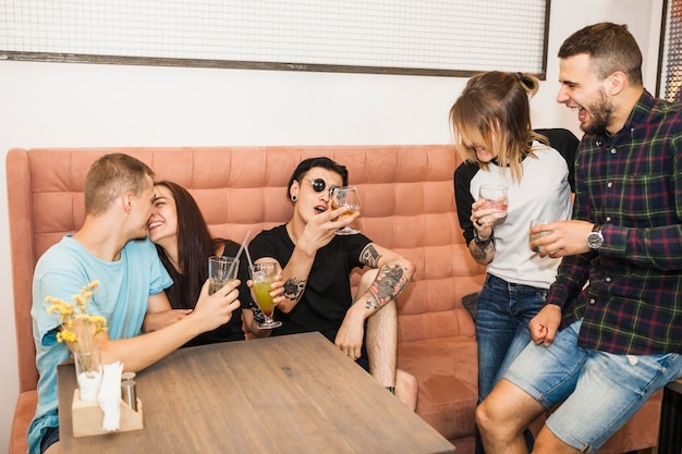 Group of friends enjoying drinks in the restaurant Free Photo