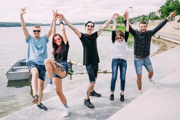 Group of friends enjoying near the lake Free Photo