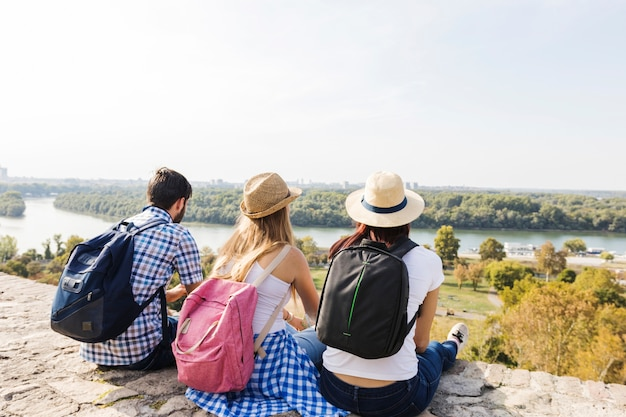 Group of friends enjoying scenic view at outdoors Free Photo