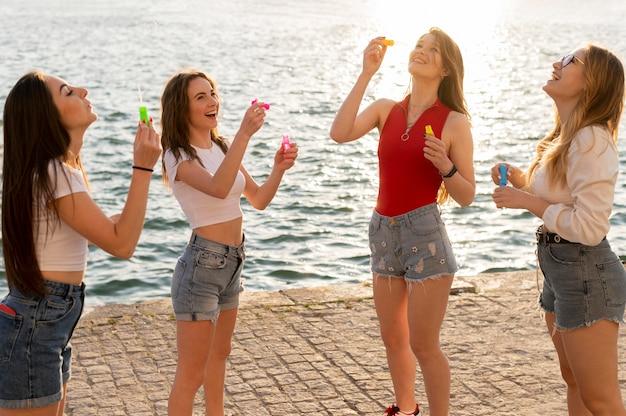 Group of friends having fun at beach Free Photo