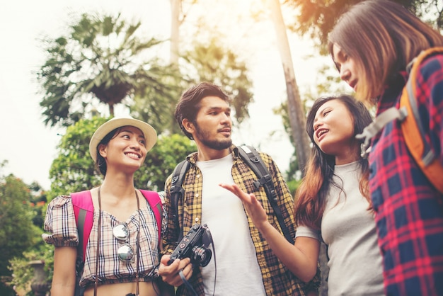 Group of friends having fun talking together while traveling in urban. Free Photo