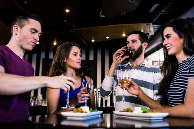 Group of friends having a glass of wine in a bar Premium Photo