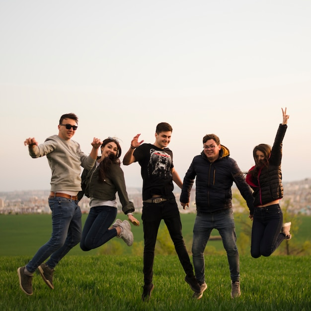 Group of friends jumping in nature Free Photo