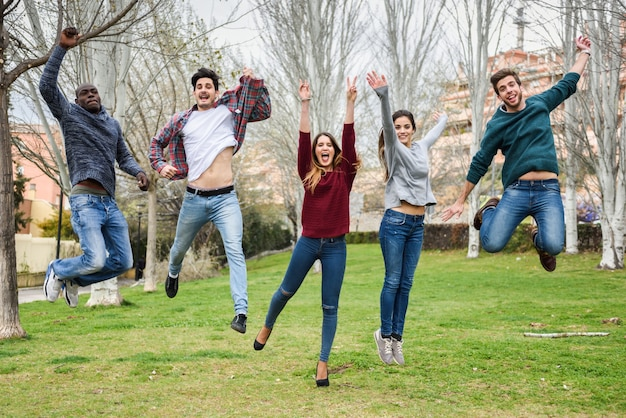 Group of friends jumping at once Free Photo