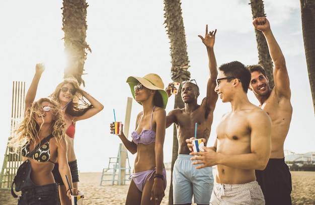 Group of friends making big party on the beach Premium Photo