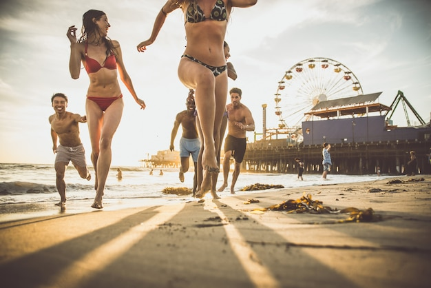 Group of friends making big party and games on the beach Premium Photo
