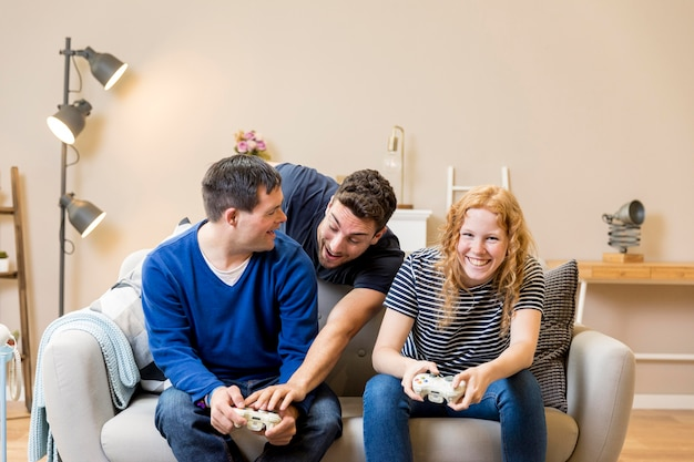 Group of friends playing video games at home | Free Photo