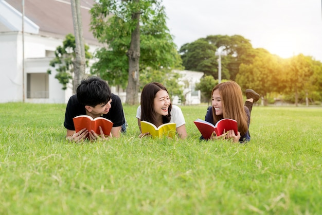 Group of friends studying outdoors in park at school. Premium Photo