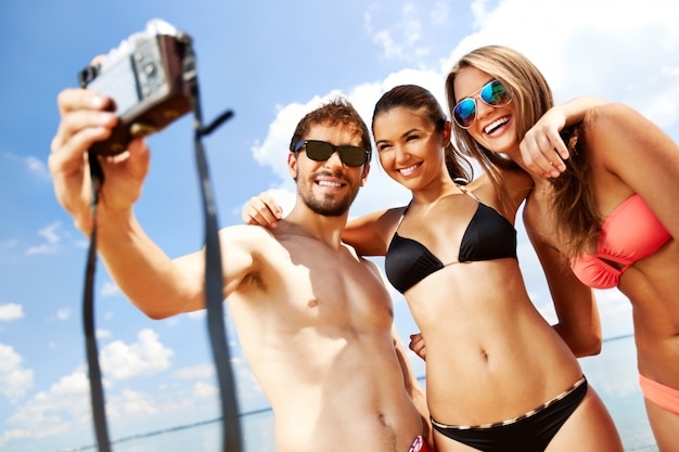 Group of friends in swimsuits taking a selfie Free Photo