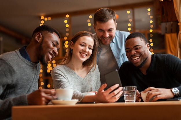 Group of friends taking selfies Free Photo