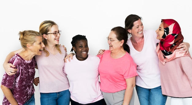 Group of girlfriends with breast cancer awareness charity Premium Photo