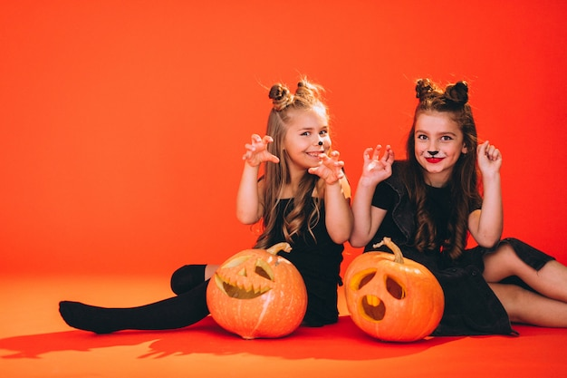 Group of girls dressed in halloween costumes in studio Free Photo