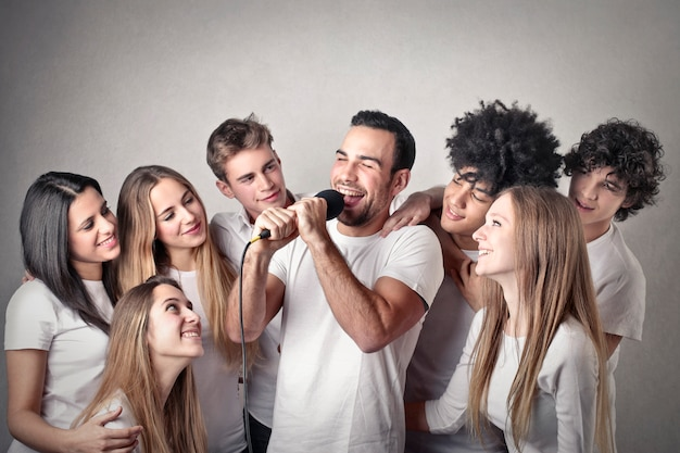 Group of girls watching a man singing Premium Photo