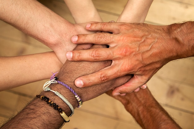 Group of hands holding together Premium Photo