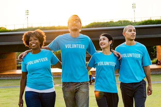 Group of happy and diverse volunteers Free Photo