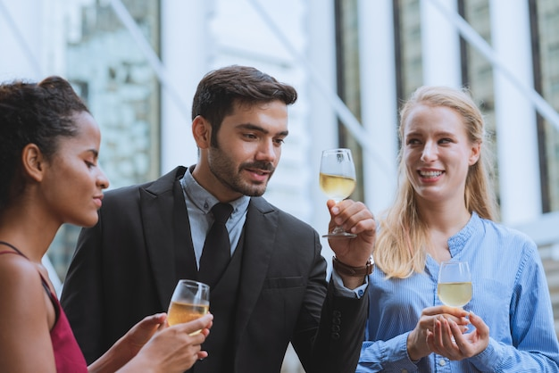 Group of happy young business with colleagues drinking champagne celebration party success to work in outdoor Premium Photo