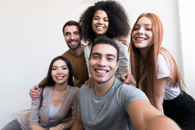 Group of happy young people taking a selfie Premium Photo