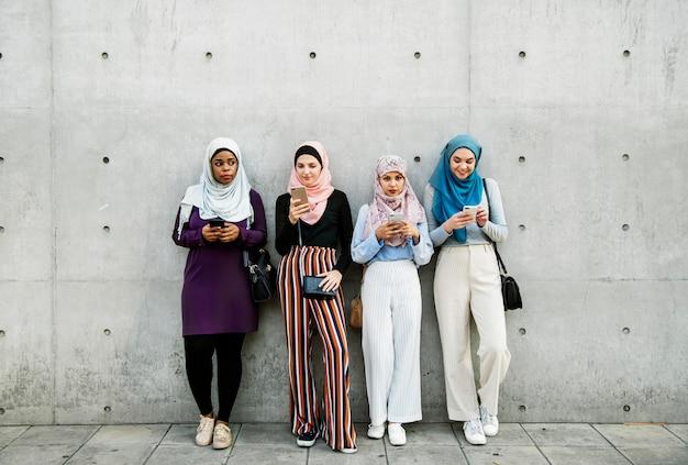 Group of islamic girls using smart phone Premium Photo