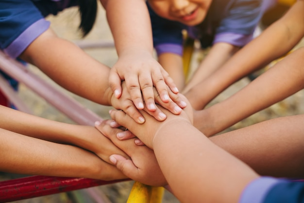 Group of kids hands of together joining for teamwork. Premium Photo