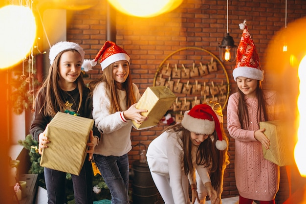 Group of kids with christmas presents Free Photo