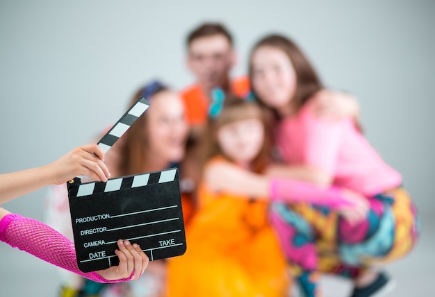Group of man, woman and teens dancer with clapperboard Free Photo