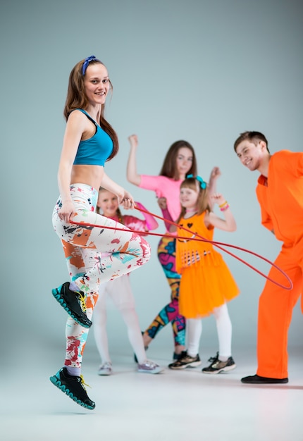 Group of man, woman and teens dancing hip hop choreography Free Photo