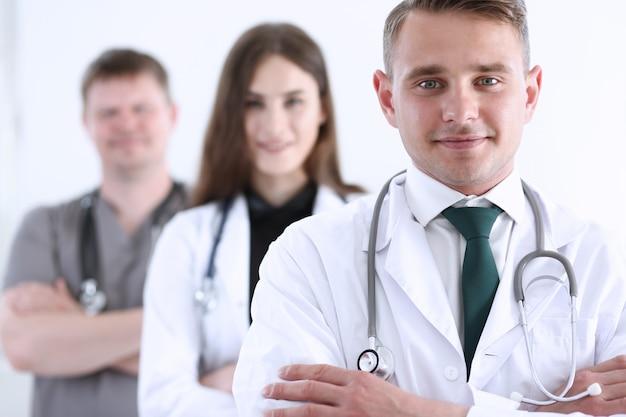 Group of medics proudly posing in row Premium Photo