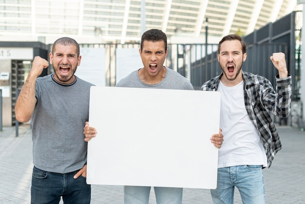 Group of men protesting together Free Photo