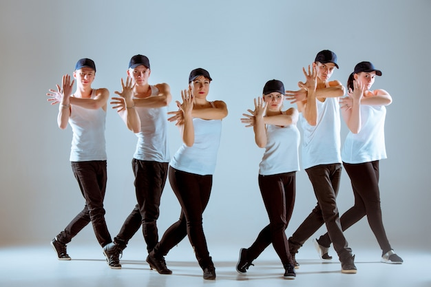 Group of men and women dancing hip hop choreography Free Photo