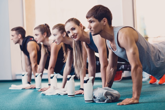 Group men and women performs a physical exercise. Premium Photo