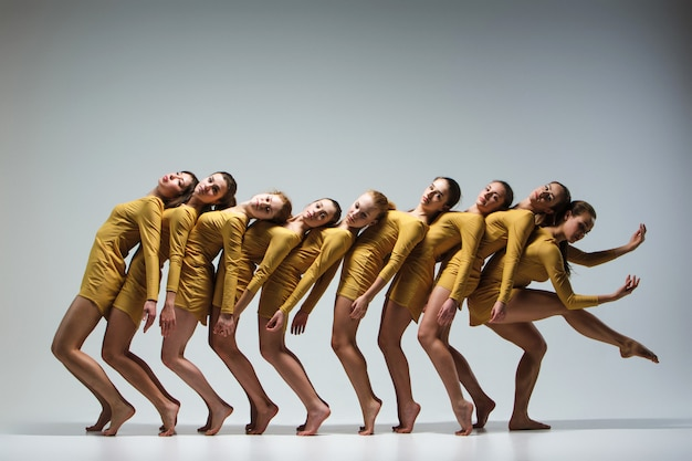 The group of modern ballet dancers Free Photo