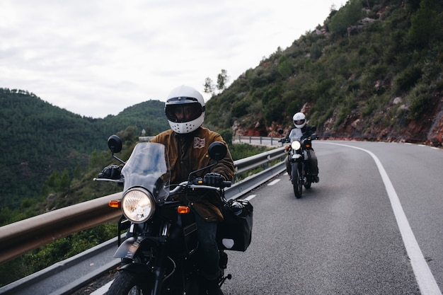 Group of motorcycle riders on mountain road Free Photo