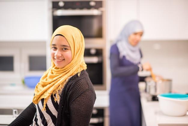 Group of muslim women in kitchen making food Premium Photo