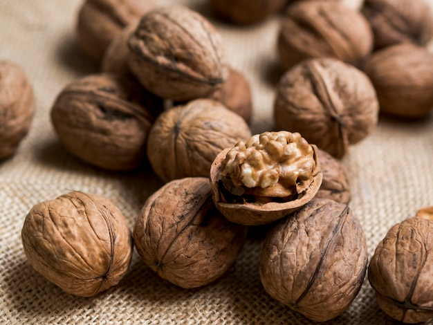 Group of nuts on brown background Free Photo