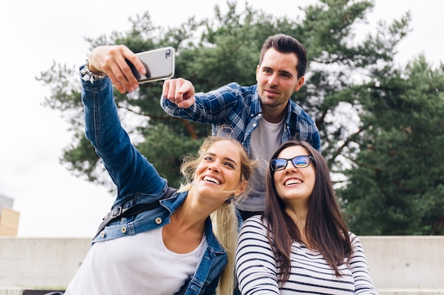 Group of friends making selfie Free Photo