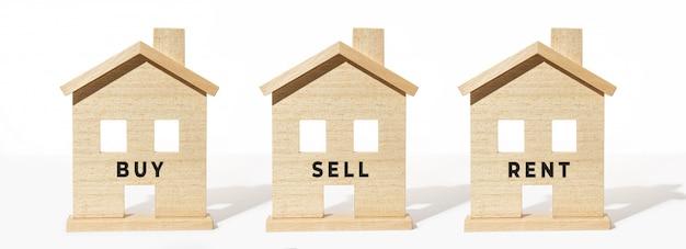 Группа в составе деревянная модель дома на белой предпосылке. купить, продать или арендовать концепцию Premium Фотографии
