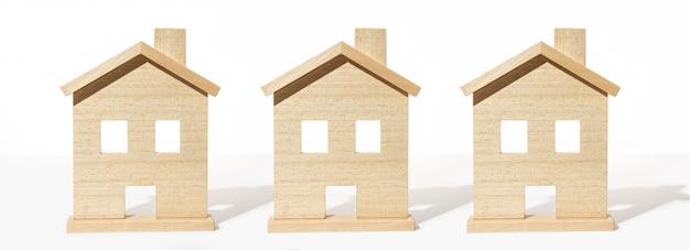 Группа модель деревянного дома на белом фоне Premium Фотографии