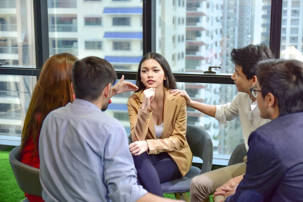 A group of people are working together to discuss mental health problems in the form of mental health, work stress. Premium Photo
