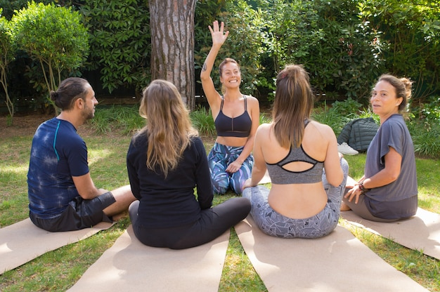 Group of people coming together for outdoor yoga Free Photo