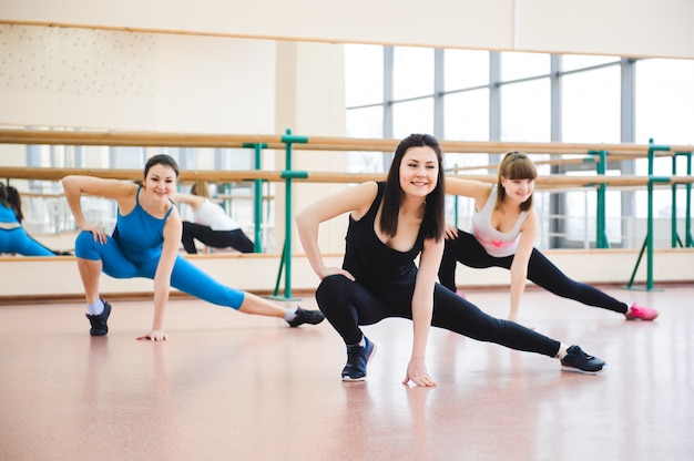 Group of people at the gym in a stretching class Premium Photo