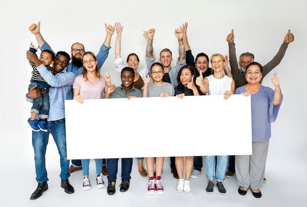 Group of people holding a banner Premium Photo