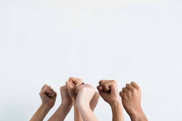 Group of people holding fists up Free Photo