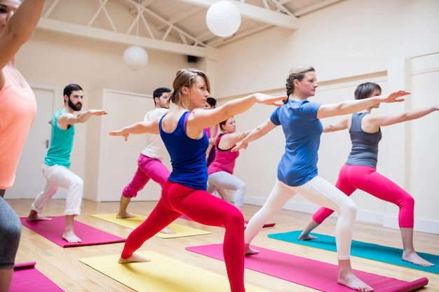 Group of people performing stretching exercise Free Photo